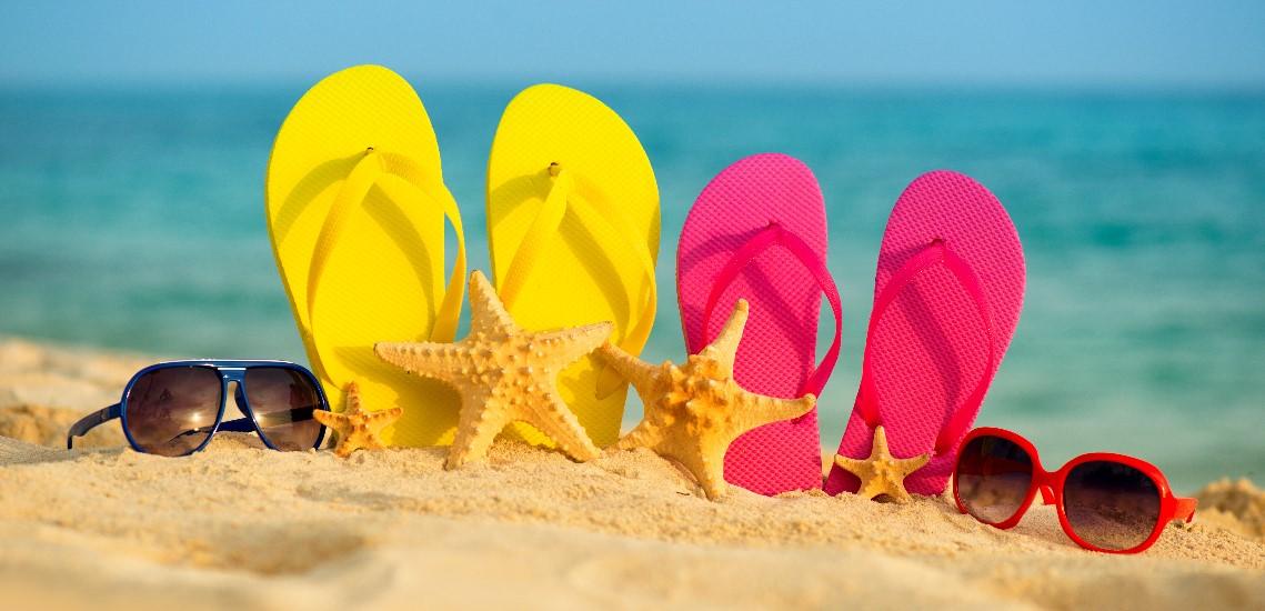 Flip flops and sunglasses on beach