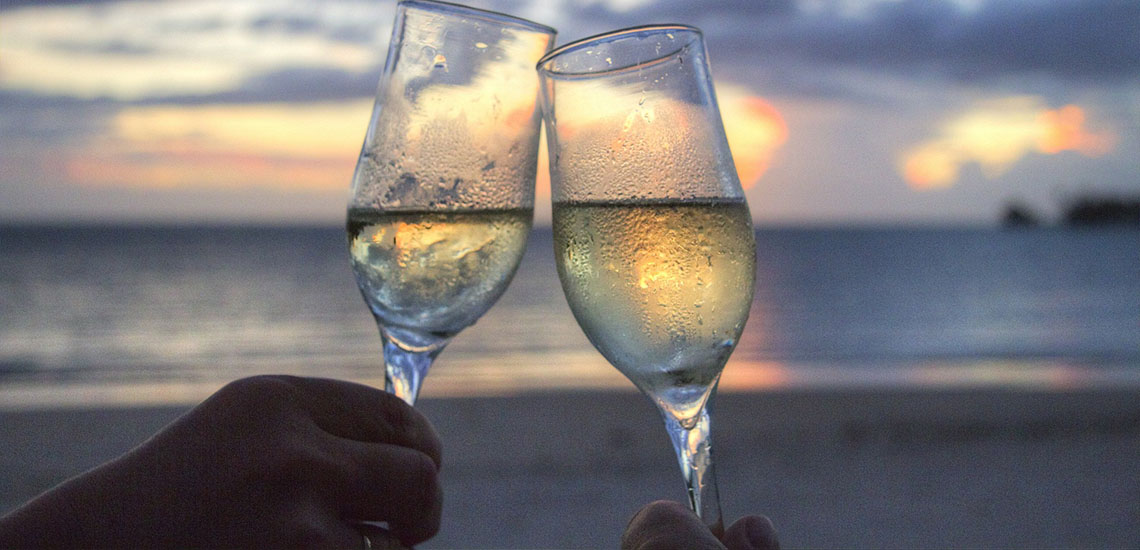 Champagne toast on beach
