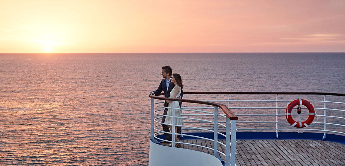Couple at the Rail at Sunset on Princess ship