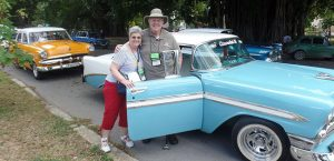 Owners with Old Styler Car in Havana, Cuba