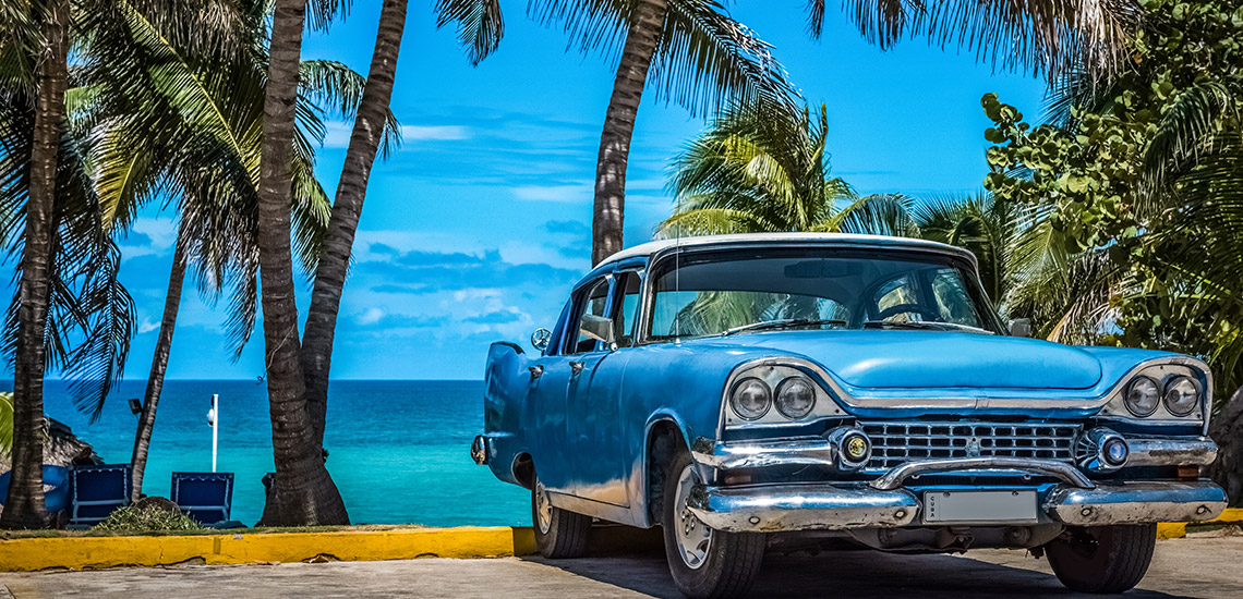 Car on beach in Havana, Cuba