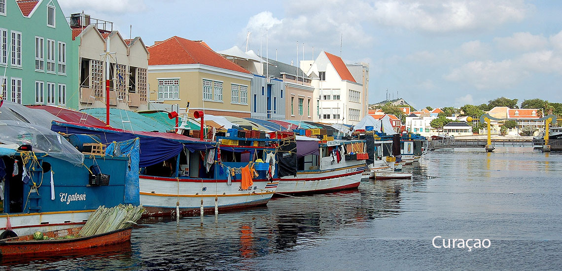 Curacao boats and colorful buildings