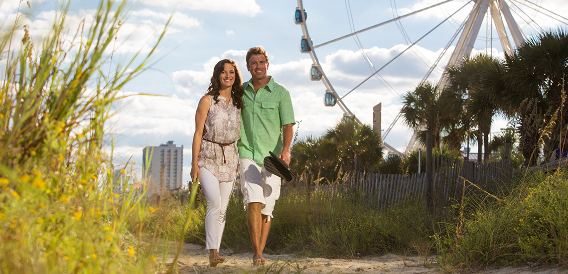 Couple in Myrtle Beach walking along the beach.