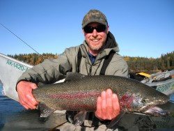 Fisherman with rainbow trout