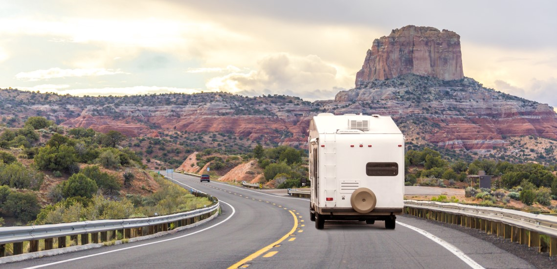 RV camper on highway in the West