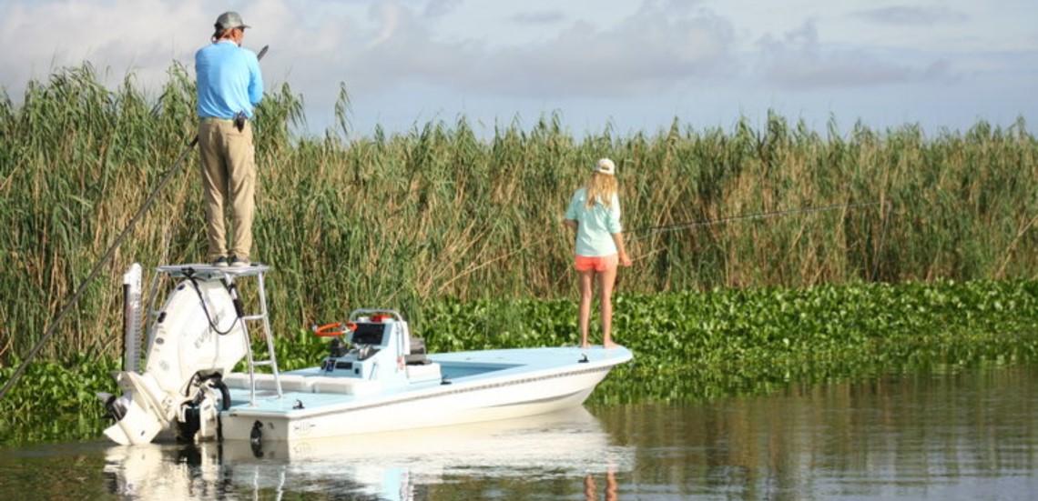 Redfishing from boat in marsh