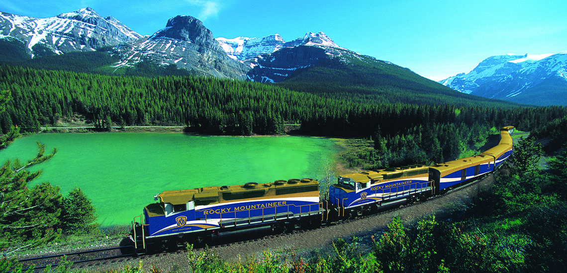 Rocky Mountaineer train passing by lakes and mountains.