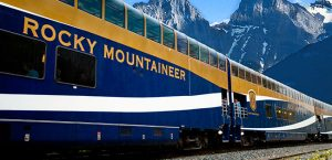 Rocky Mountaineer train going through Canadian Rockies.