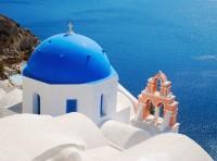 Blue-domed church in Santorini, Greece