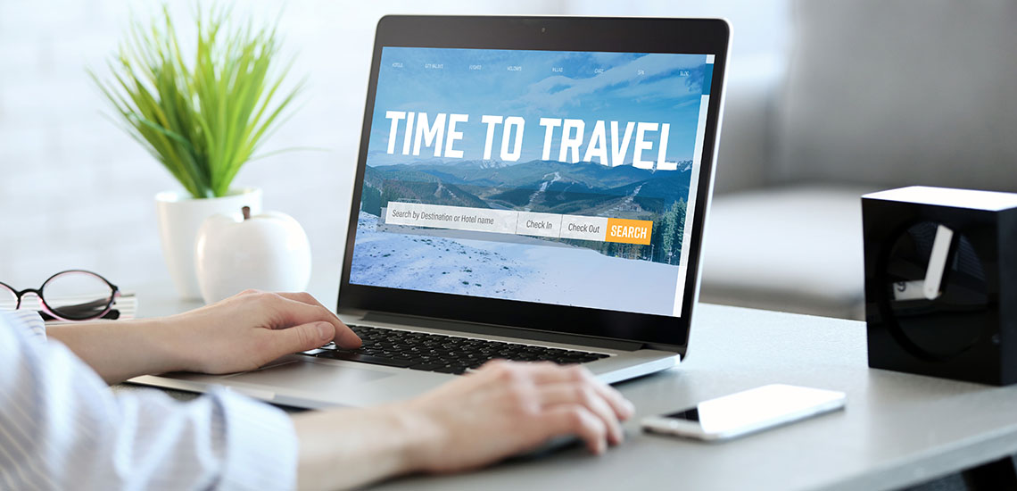 Man booking travel online
