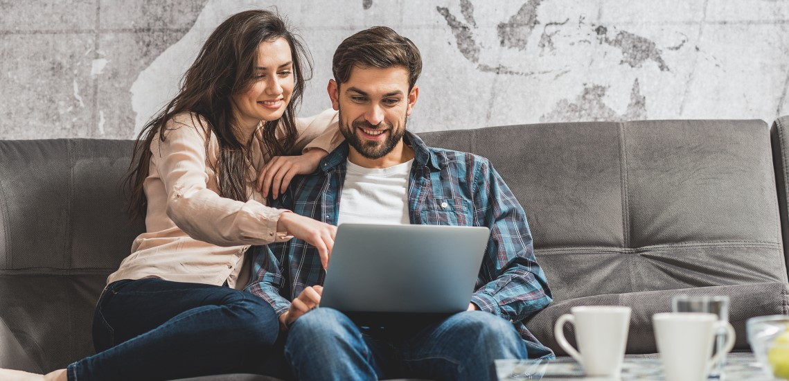 Couple watching a webinar on laptop